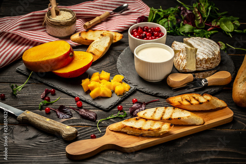 Aluminium Prints Picnic Toasts of cheese, Alphonso mango. Bruschetta with mango and cheese. Homemade. Healthy vegetarian nutritionon a wooden background, Top view. Copy space