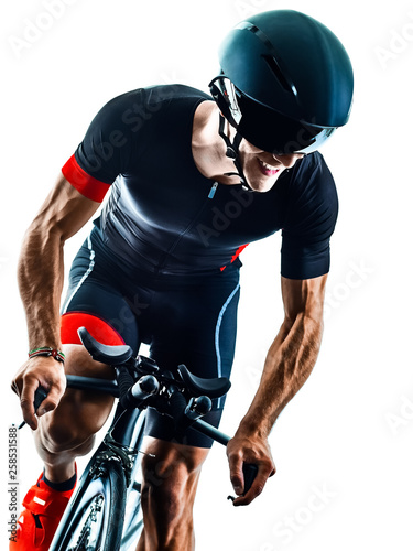 Fotografia triathlete triathlon Cyclist cycling  in studio silhouette shadow  isolated  on