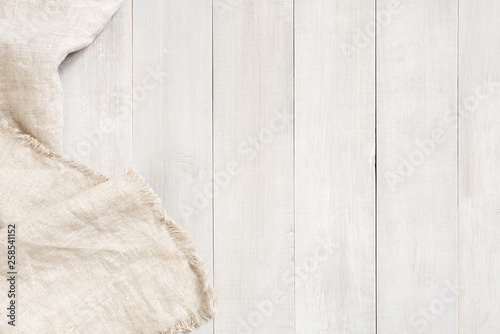 Obraz na plátně White wooden background decorated with linen napkin