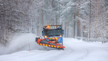 Snowplow Truck Clearing A Snow-covered Icy Road