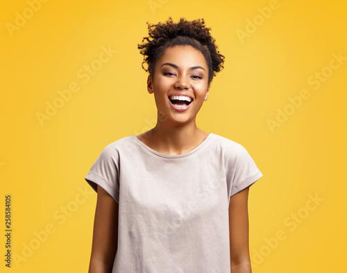 Fotografia  Joyful student laughs at good joke