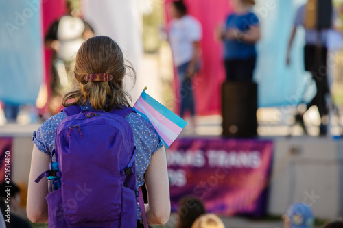 Woman with Backpack and Trans Support Flag at Rally Canvas Print