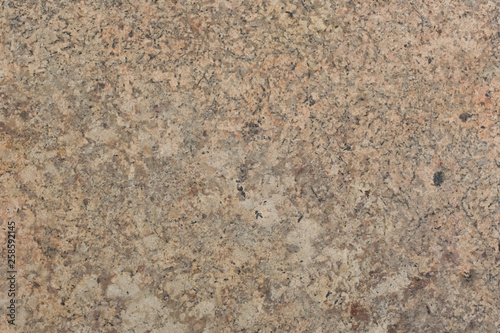 Natural light grey granite texture.