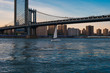 View of the Brooklyn bridge during a dusk from East river. New York City