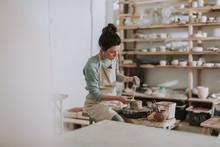 Female Ceramic Artist In Apron...