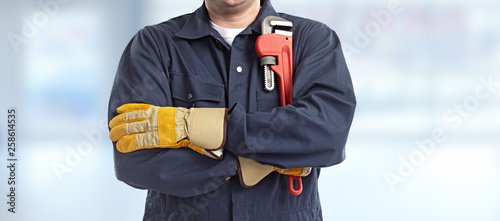 Foto Plumber hand with wrench.