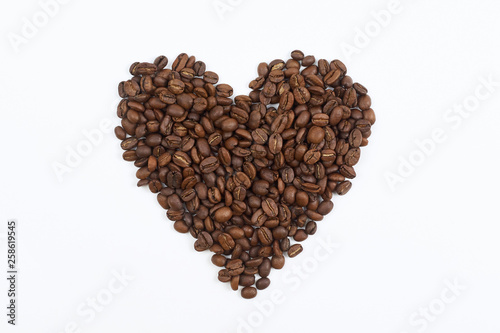 Canvas Prints Coffee beans heart lined with coffee beans on white background