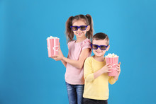 Cute Children With Popcorn And Glasses On Color Background