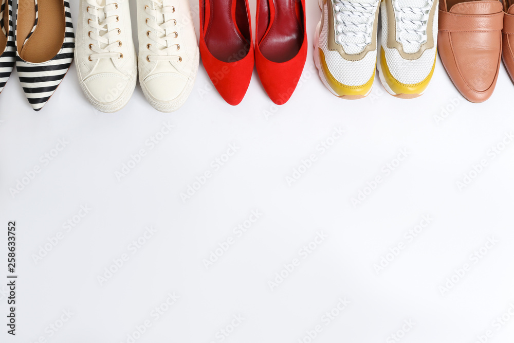 Fototapety, obrazy: Different shoes on white background, top view