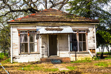 Front Of Uninhabitable Abandoned Home