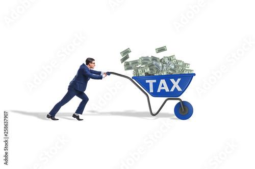 Obraz na płótnie Businessman pushing wheelbarrow full of money in tax concept