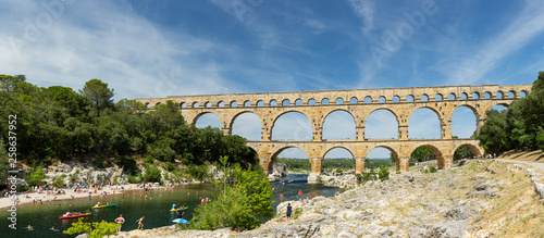 Staande foto Artistiek mon. Gard, France July 13th 2015 : The magnificent three tiered Pont Du Gard aqueduct was constructed by Roman engineers in the 1st century AD in the south of France