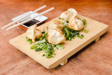 Gyoza With Soy Sauce On A Wood...