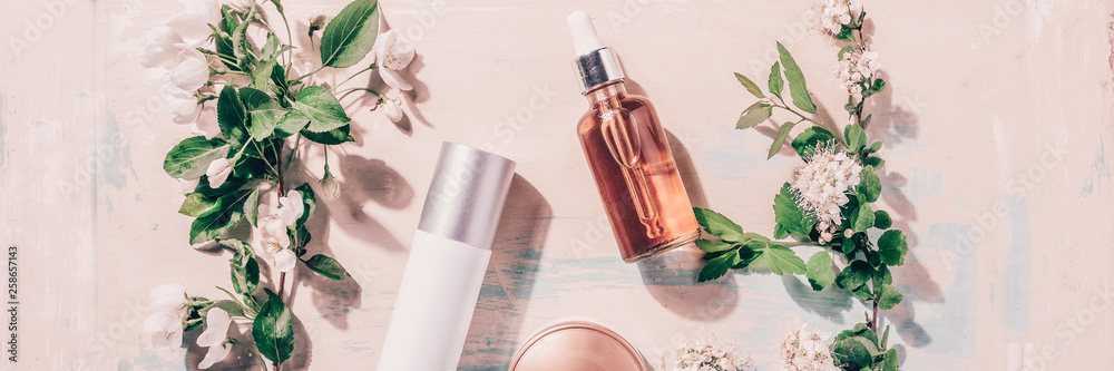 Fototapety, obrazy: Natural organic cosmetics: serum, cream, mask on wooden background with flowers. Spa concept