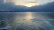 4K. Sunset in the icy Lake Baikal Irkutsk region Russia. Ultra HD 4096x230