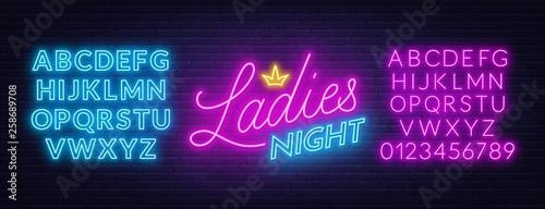 Fototapeta Ladies Night neon lettering on brick wall background.