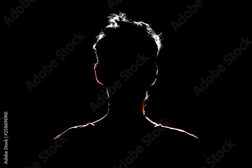 silhouette of man in dark place, anonymous backlit contour a Canvas Print