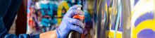 Artist Holdong A Spray Paint C...