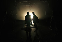 Silhouettes Of Explorers Insid...