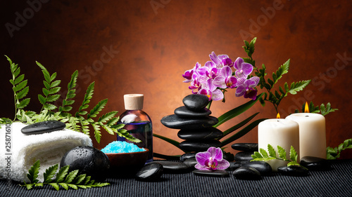 Fotografie, Obraz  candle light spa treatment set with aromatic salt, perfumed essence, stones and