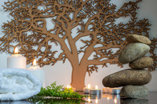 Zen Rocks And Candles With Tree Of Life In The Background
