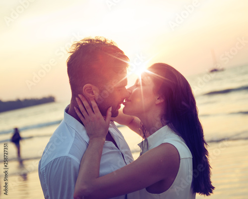 Valokuva Romantic couple kissing on a hot, tropical beach