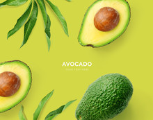 Creative Layout Made Of Avocado. Flat Lay. Food Concept. Macro Concept. Green Background.
