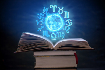 Open book on astrology on a...