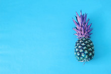 Pineapple Painted On Blue Color Lays On Blue Background With Copy Space, Futuristic Background,concept