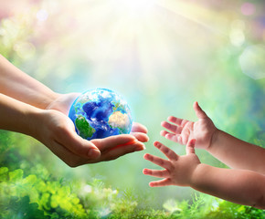 Fototapeta Do biura Mother Give Blue Earth In Daughter Hands - elements of this image furnished by NASA - 3d Rendering