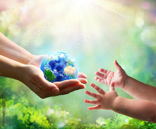 Fototapeta Mother Give Blue Earth In Daughter Hands - elements of this image furnished by NASA - 3d Rendering obraz