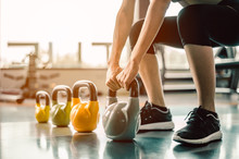 Exercising With A Kettlebell At The Gym.