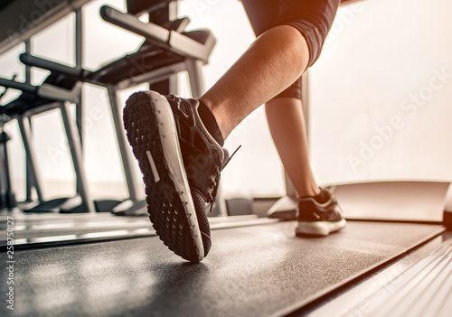 Fotografija  Close up on shoe,Women running in a gym on a treadmill