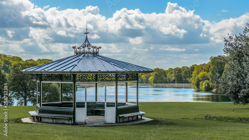 Victorian bandstand in Roundhay public park Leeds Yorkshire England with Waterloo Lake behind Canvas Print