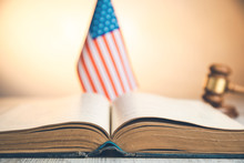 American Flag With Book And Judge On Desk