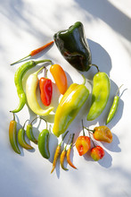 Overhead View Of Assorted Peppers In Sunlight