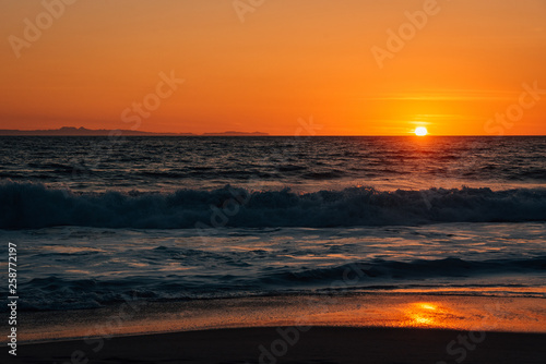 Sunset and waves in Pacific Ocean at Thousand Steps Beach, in Laguna Beach, Orange County, California