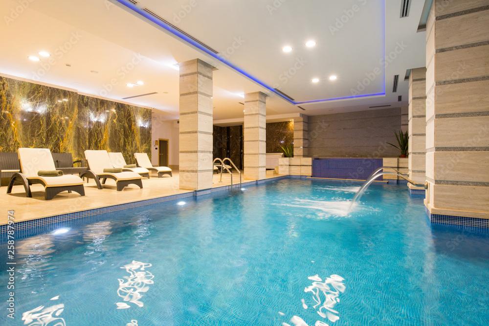 Fototapeta Swimming pool in hotel spa and wellness center