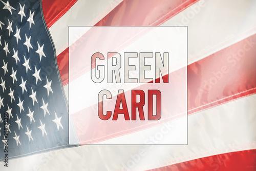 Valokuva  Green Card on a USA flag background