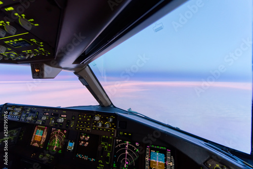 Beautiful twilight sunset sky at high altitude from airplane cockpit view Tablou Canvas