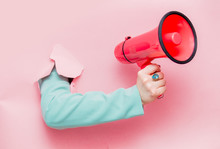 Female Hand In Classic Blue Jacket With Megaphone