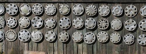 Fényképezés Big collection hubcaps on wall