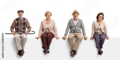 Pinturas sobre lienzo  Two senior men and two senior women sitting on a white panel and posing