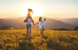 canvas print picture - Happy family: mother, father, children son and daughter on sunset.