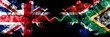 canvas print picture - United Kingdom vs South Africa, African smoky mystic flags placed side by side. Thick colored silky smoke flags of Great Britain and South Africa, African.
