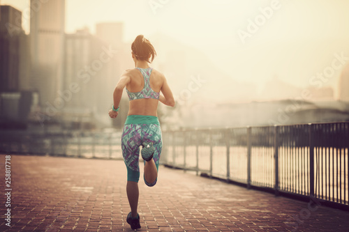 Staande foto Jogging Healthy lifestyle woman runner running on foggy city