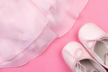 Pink Dance Shoes And Tulle Tutu On Pink Background