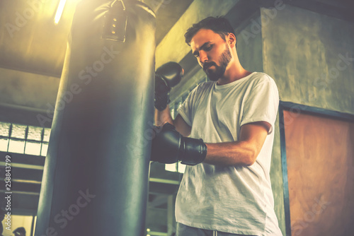 a man workout with punching bag in sports gym Canvas Print