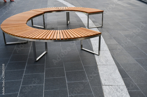 Foto auf AluDibond Grau Round wooden and aluminum bench for public urban space.