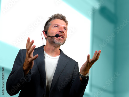 Stampa su Tela confident successful man with headset speaking at corporate business coaching an